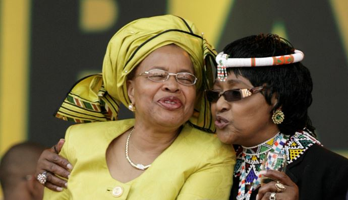 Graca Macel and Winnie Madikizela Mandela embrace each other.